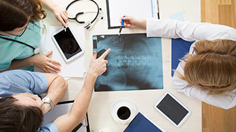 Doctors Discuss an Xray