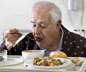 Man eating hospital food